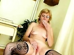 Sexy milf teacher wears glasses and fingers herself like